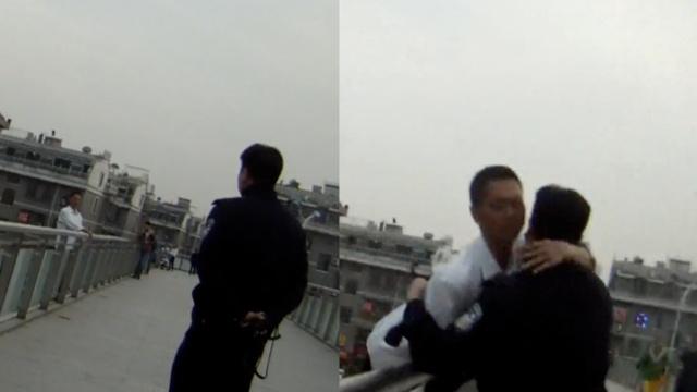 男子欲跳桥轻生,被救后紧抱民警