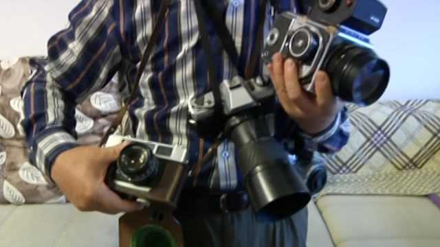 照相機記錄美好生活和改革開放成績