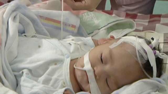 2月大男婴被弃医院门口,母留1封信
