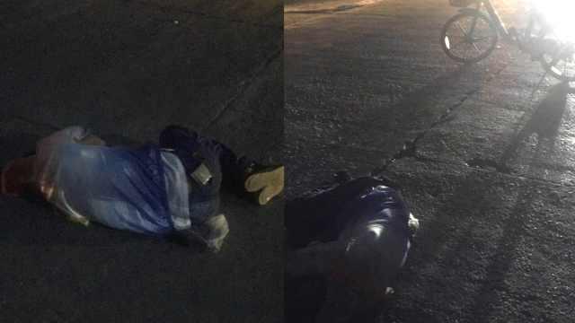 的哥凌晨守护躺马路醉汉,用手机灯光指引过往车辆