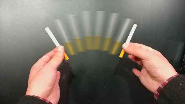 魔术:一根香烟瞬间变成了两根!