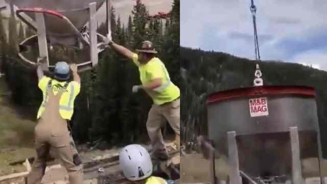 厉害了!工人利用直升机倒水泥施工