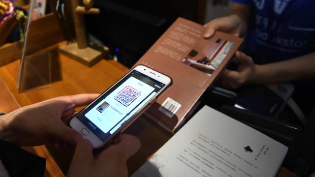 全球首家共享书店体验:新书免费借