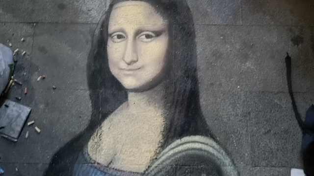 流浪汉街头画蒙娜丽莎:用心才有钱