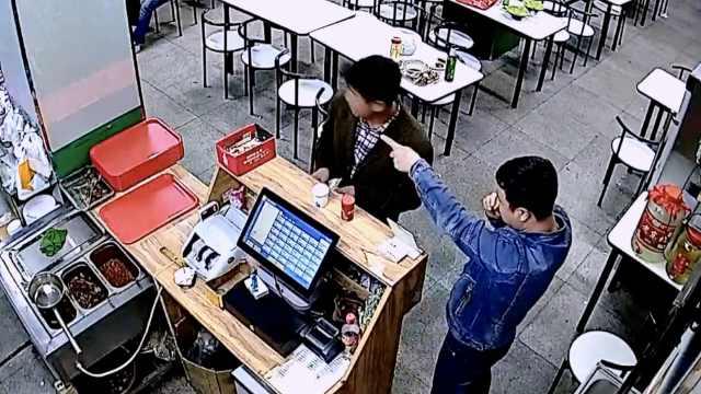 看那边!他饭店盗手机,声东击西秒偷