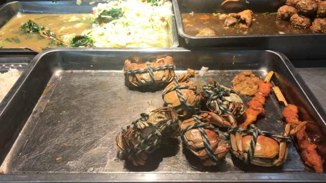 食堂卖螃蟹20元/只,学生:食堂有矿