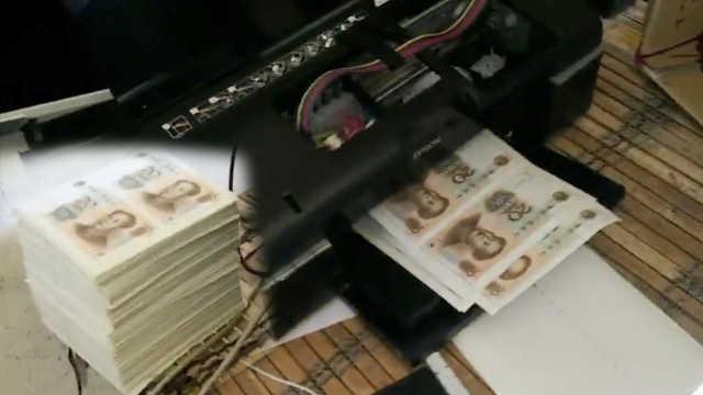 团伙打印机印20元假钞,面值达21万