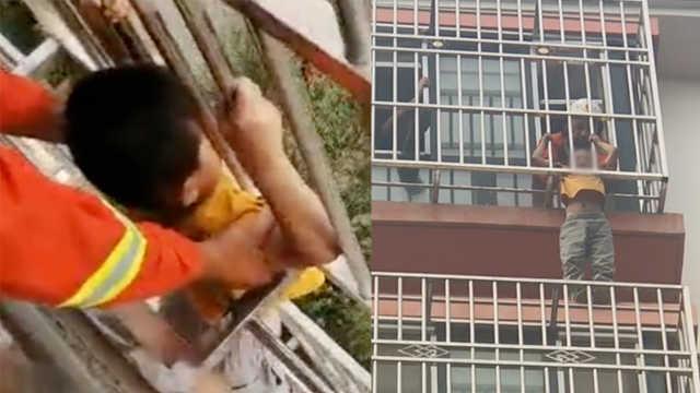 小孩悬空卡6楼窗外,消防托举20分钟