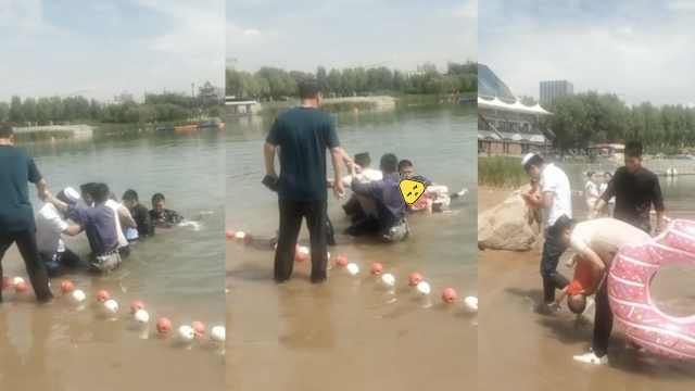 母救落水儿也溺水,众人手拉手救起