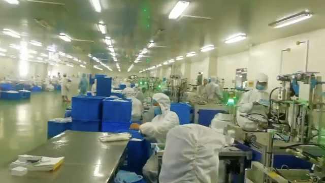 直击生产!工厂加班日产14万只口罩