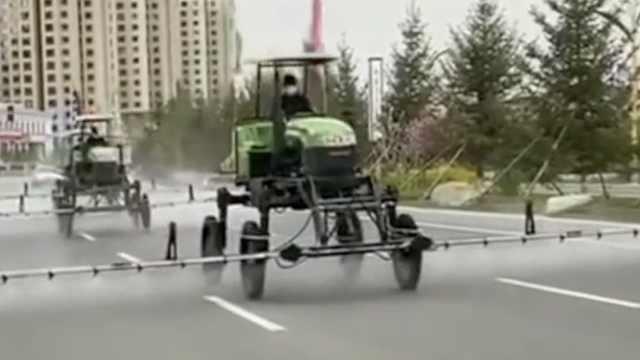 舒兰农机老板出动3台农用车,自购千斤消毒液为市区街道消杀