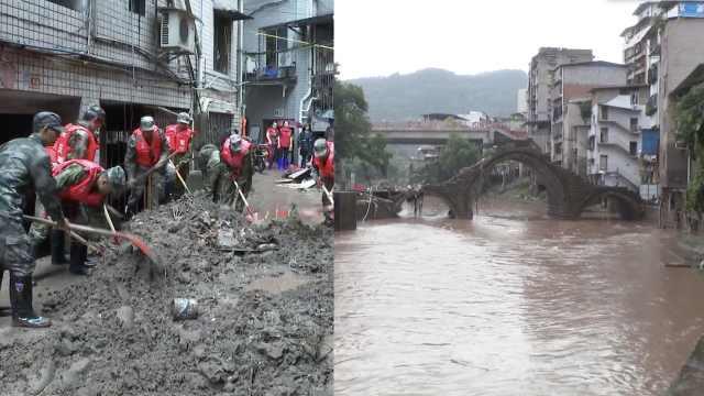 重庆万州洪水退去,屋内淤泥没脚屋外杂草挂电