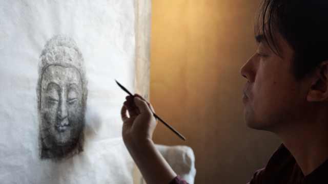 画家10年绘制百张天龙山佛像,水墨再现百年前样貌