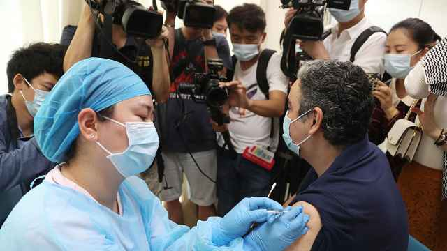 直击!港澳和外籍人士新冠疫苗首日开打