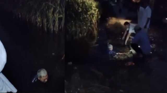 涵管被堵洪水浸泡庄稼,7旬白发老人下臭水沟