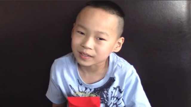 腦癱男孩受捐助:掙很多錢回報社會
