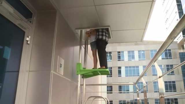 发明不用电的电梯,用于火灾逃生